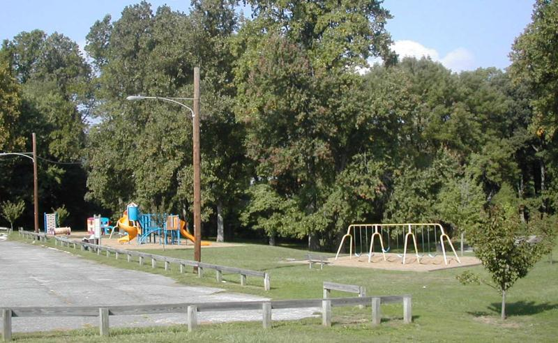 A Small Playground and Swingset Beside a Parking Lot at the Marple Gradens